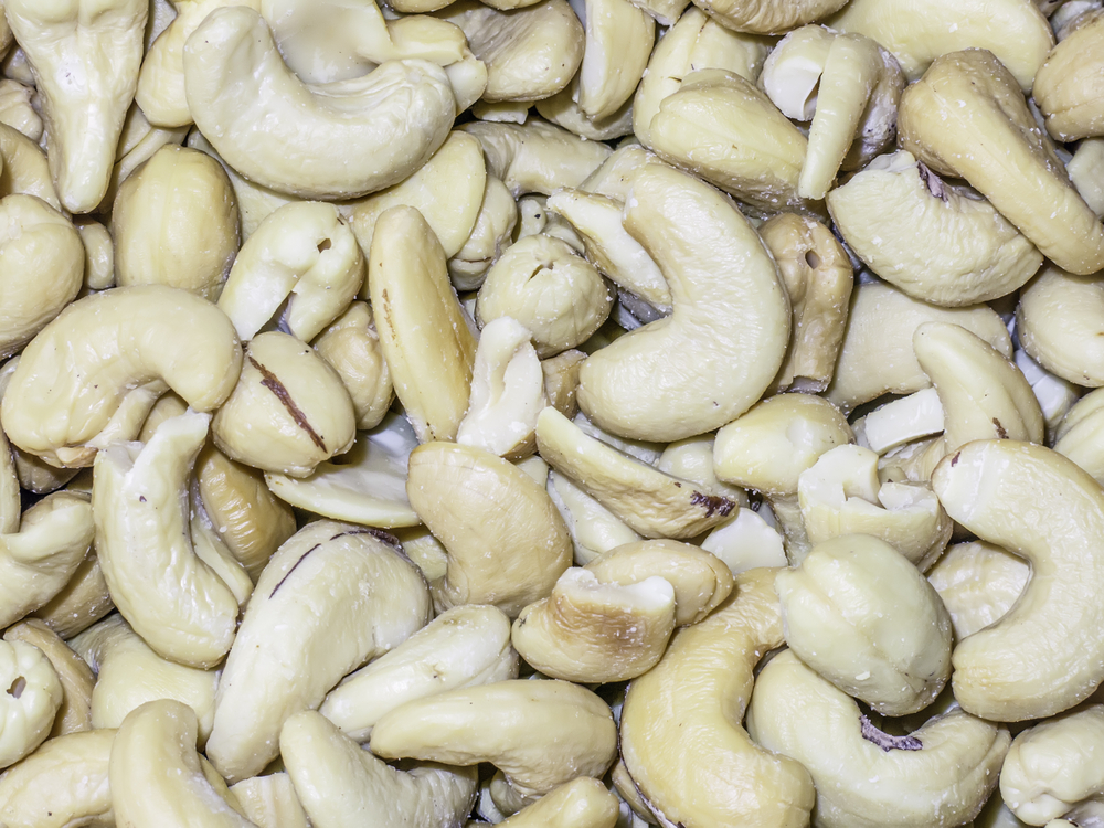 Closeup of roasted cashew nuts (a healthy food), lightly salted