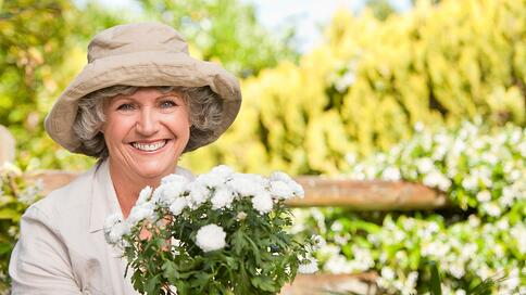 Smiling woman in her garden